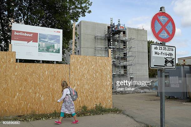 A little girl walks past the construction site of a new shelter for refugees in RudolfLoenhardStrasse in Marzahn district on September 20 2016 in...
