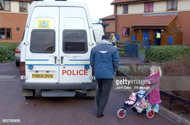 A little girl watches the scene after Cleveland Police arrest a man in the Longlands area of Middlesbrough after a quantity of heroin a box of...