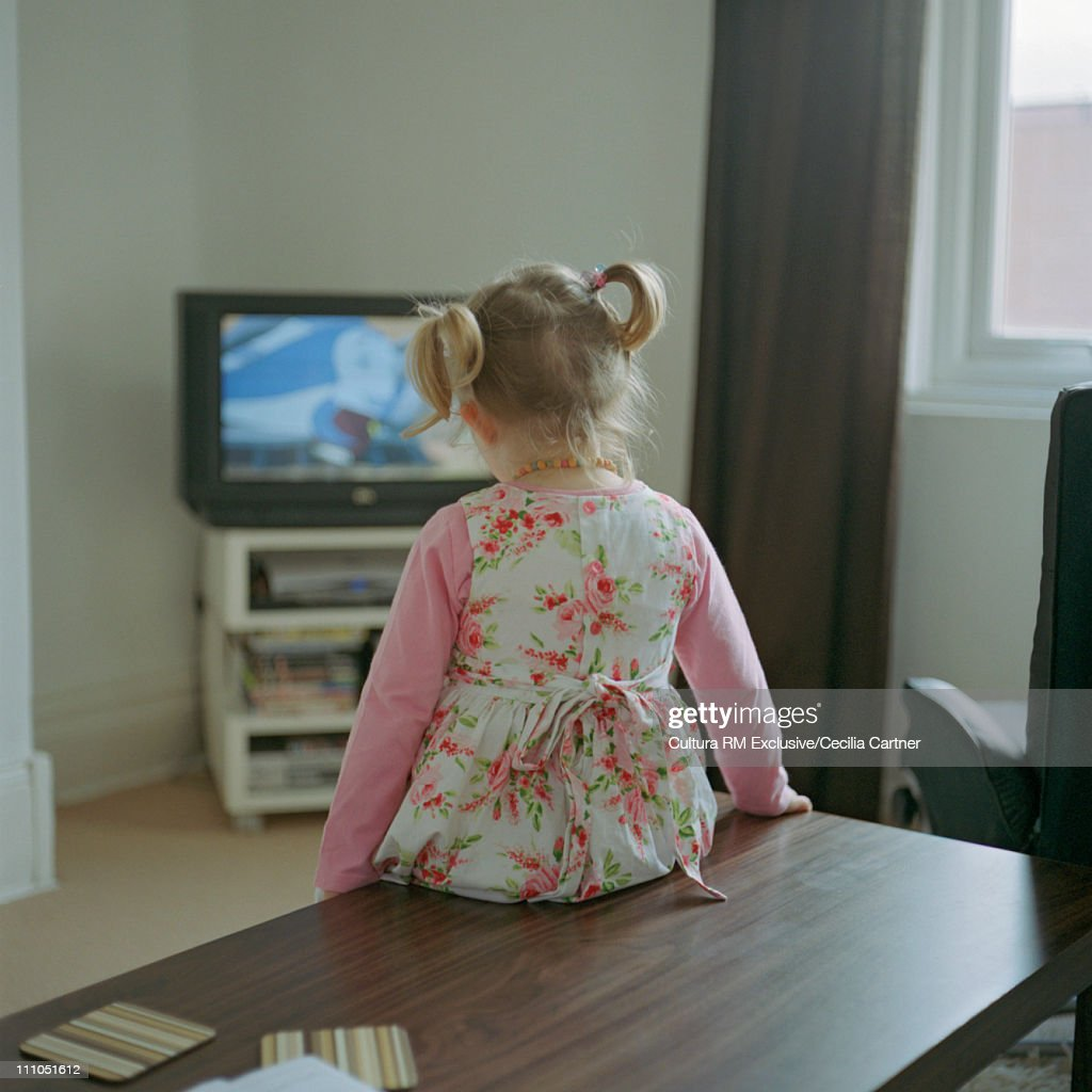 girl watching tv stock photos and pictures getty images