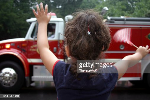 Little Girl Waves at Patriotic Parade