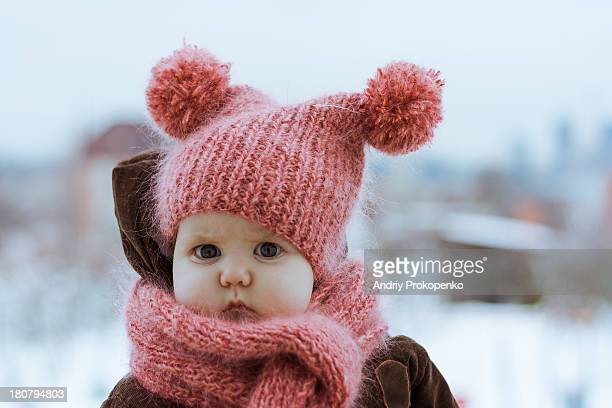 Little Girl Wearing a Pink Knitted Hat and Scarf