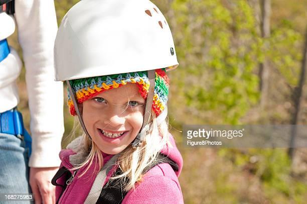 Little Girl wearing climbing helmet