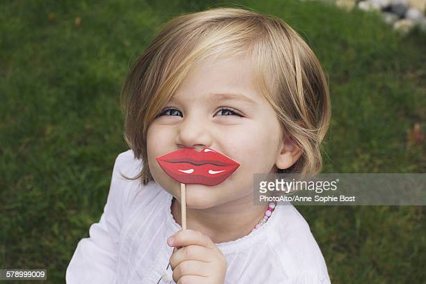 Little girl wearing costume lips