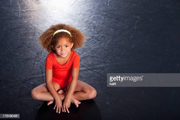 Little girl wearing leotard