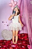 Little girl wearing princess crown and tutu