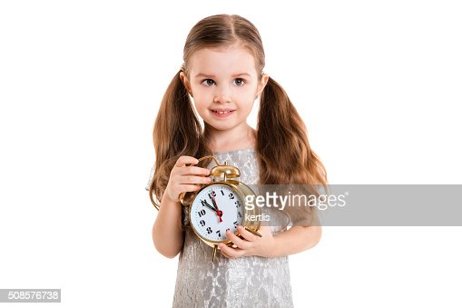 little girl with alarm clock (isolated on white background, isolated) : Stock Photo