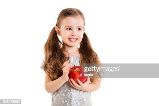 little girl with apple(isolated on white background, isolated) : Stock Photo