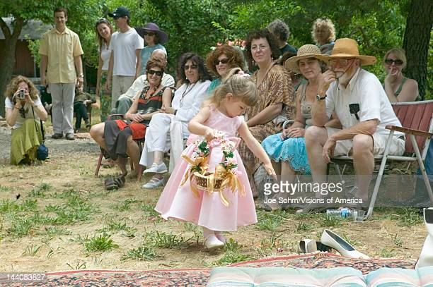 Little girl with basket of flowers at a traditional Jewish wedding in Ojai CA