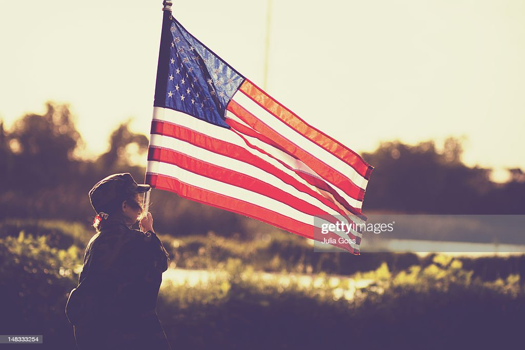 Little girl with big US flag : Stock Photo