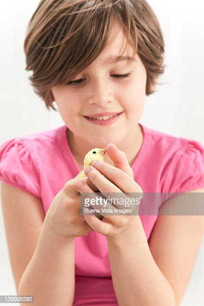 Little girl with canary bird