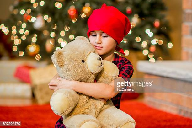 Little Girl with Cancer Holding Her Teddy Bear