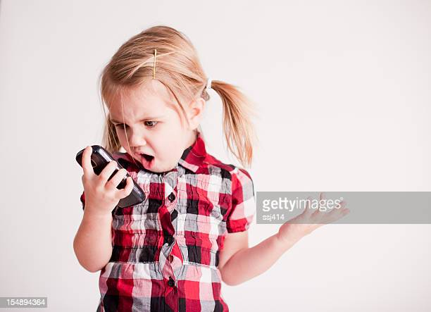 Little Girl with Cell Phone Showing Shocked Face