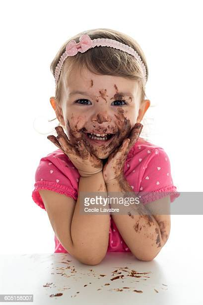 Little girl with chocolate over face