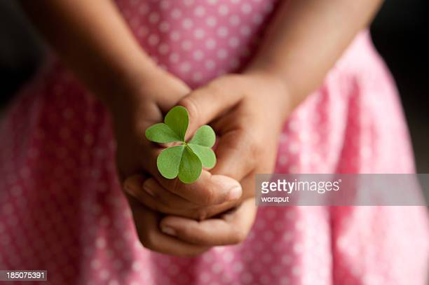 Little girl with clover leaf