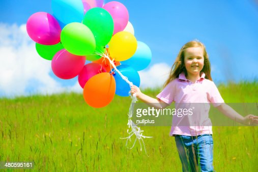 little girl with colorful balloons : Stock Photo