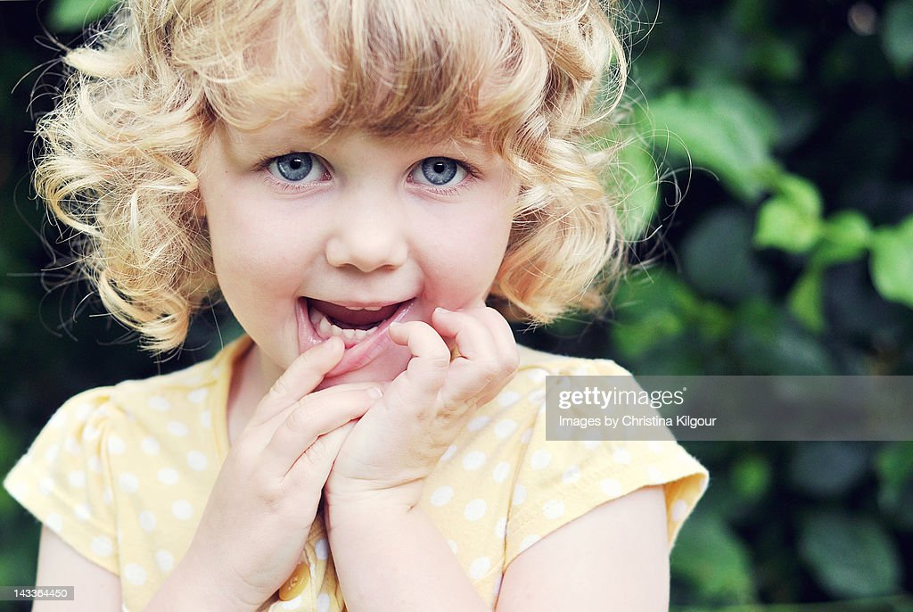 little girl with curly blonde hair stock photo getty images