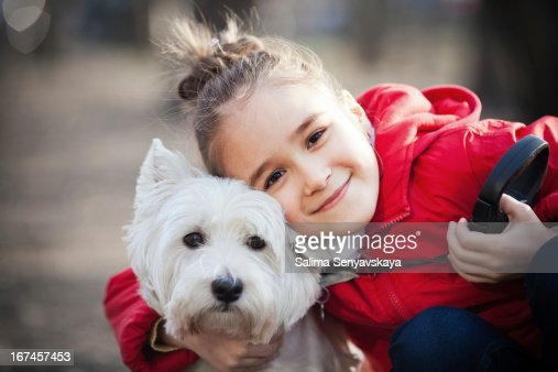 Little girl with dog : Stock Photo