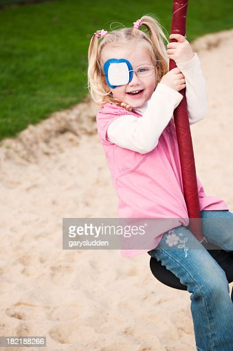little girl with eye patch having fun