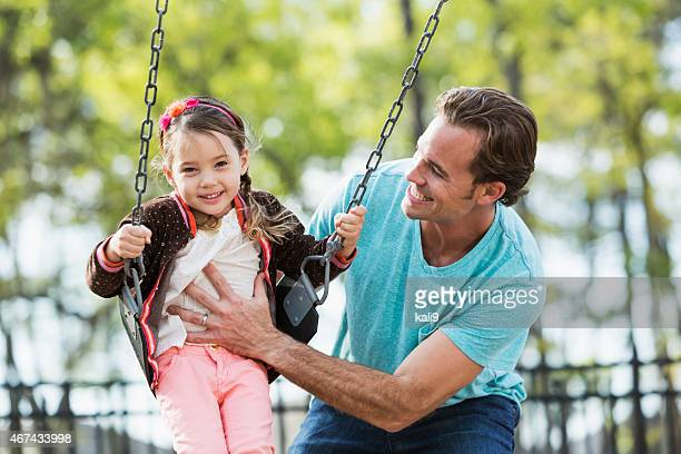 Little girl with father at park