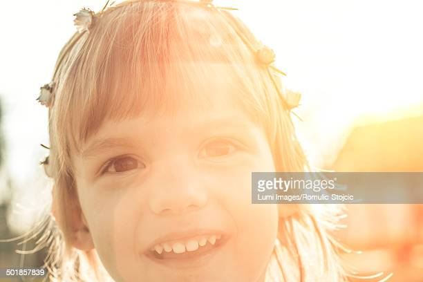 Little girl with flowers in hair