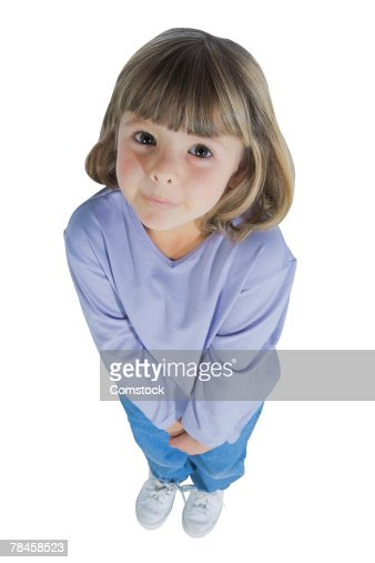 Little girl with hands clasped in front of her