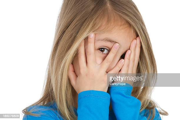 Little girl with hands on her face