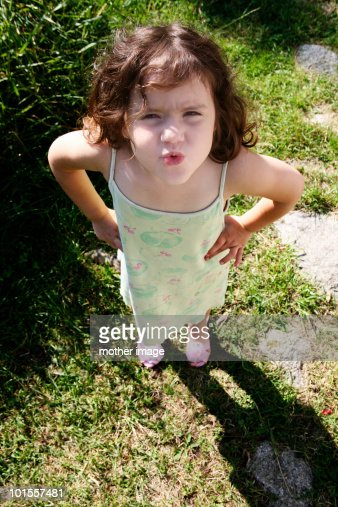 Little girl with hands on hips speaking her mind : Stock Photo
