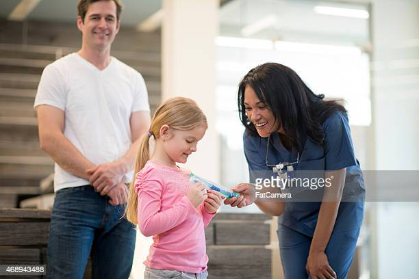 Little Girl with her Father at the Dentist