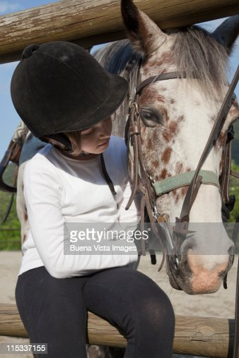 Little girl with her horse : Stock Photo