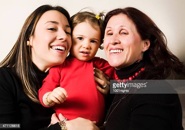 little girl with her mom and grandmother