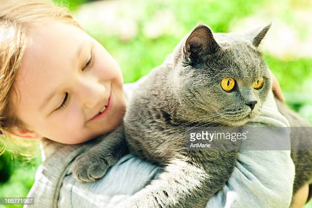 Little girl with his cat