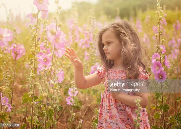 Little Girl With Hollyhocks