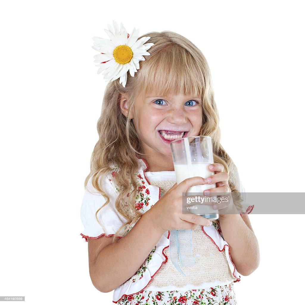 Little girl with milk mustache : Stock Photo