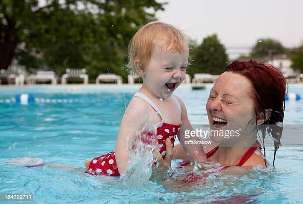 Little girl with mom at the pool