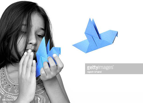 Little girl with origami birds