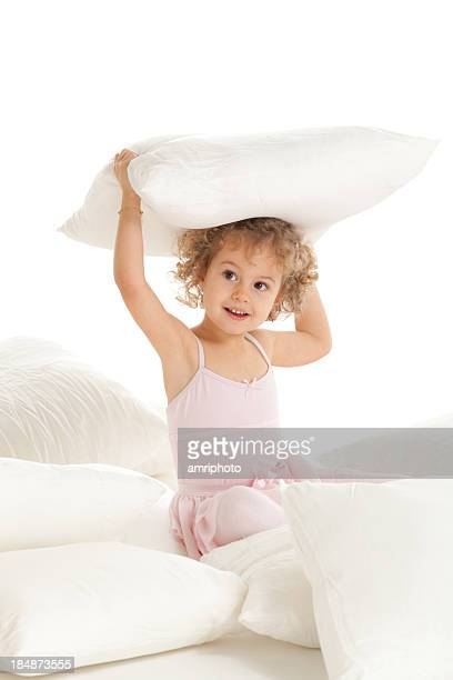 little girl with pillows