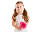 little girl with pink flower (isolated on white background, isolated)