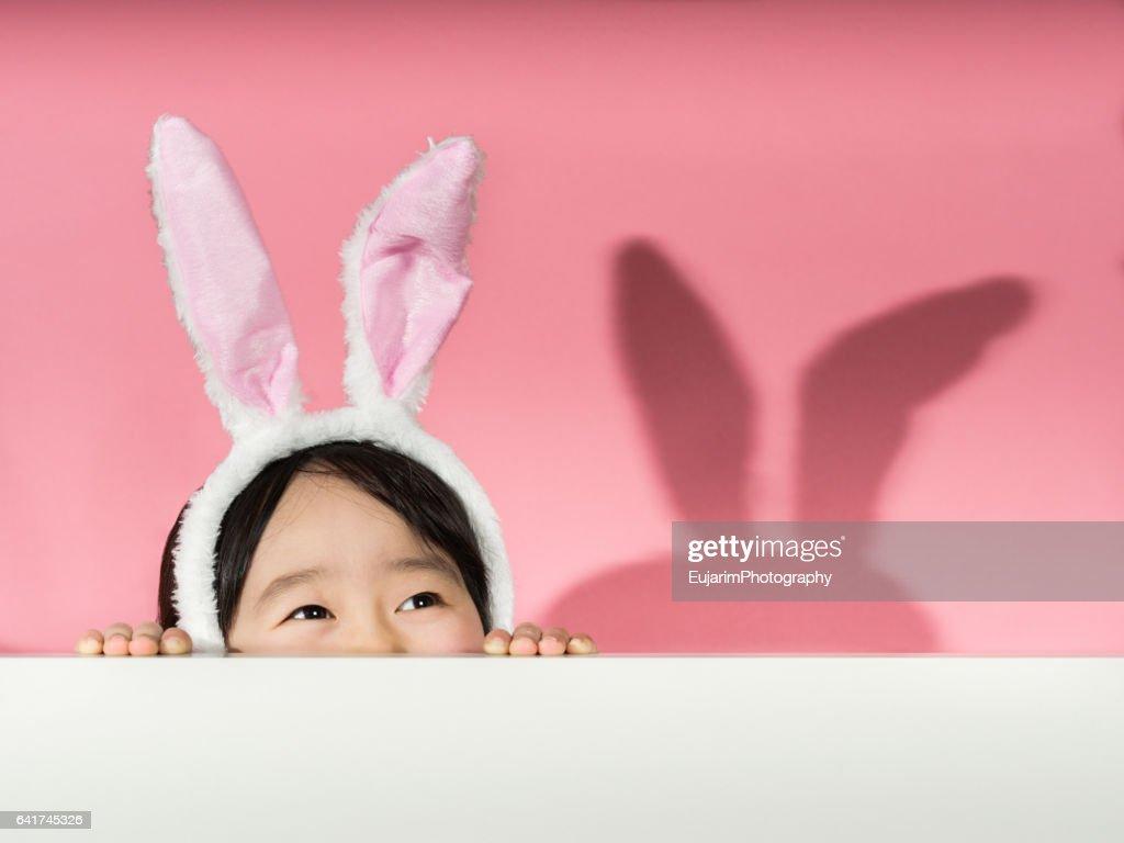 Little girl with rabbit ears headband : Stock Photo
