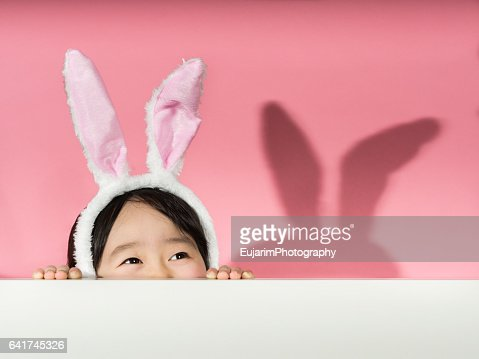 Little girl with rabbit ears headband : Stock Photo