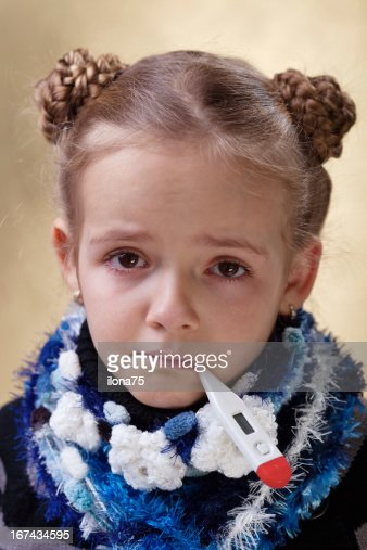 Little girl with red eyes having the flu : Stock Photo