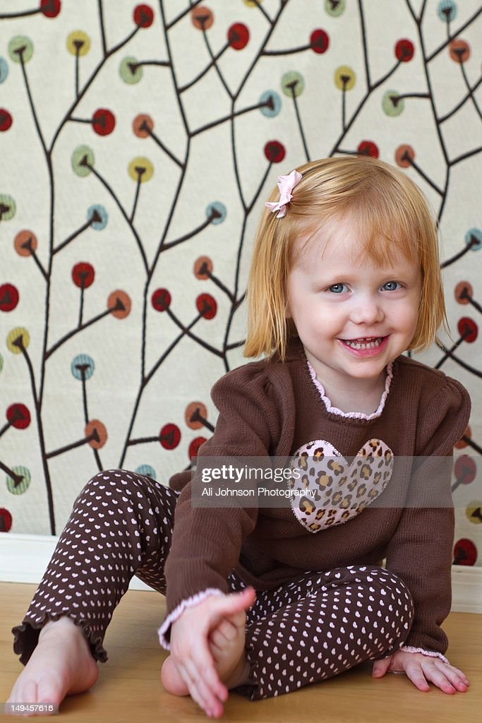 Little girl with red hair : Stock Photo