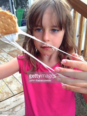 Little girl with smores treat