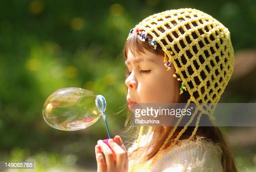 Little girl with soap bubbles : Stock Photo