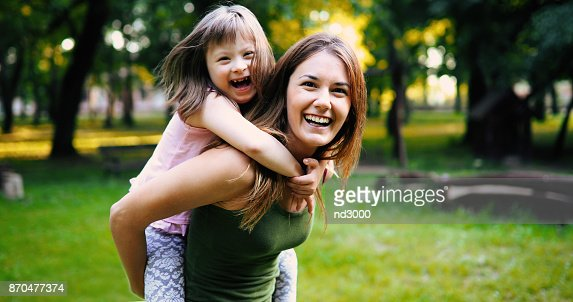 Little girl with special needs enjoy spending time with mother : Stock Photo