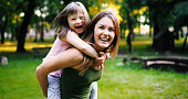 Little girl with special needs enjoy spending time with mother in nature