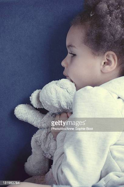 Little girl with stuffed toy