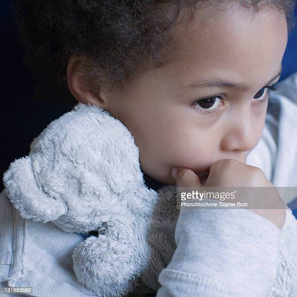 Little girl with stuffed toy, portrait