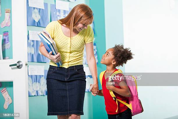 Little girl with teacher