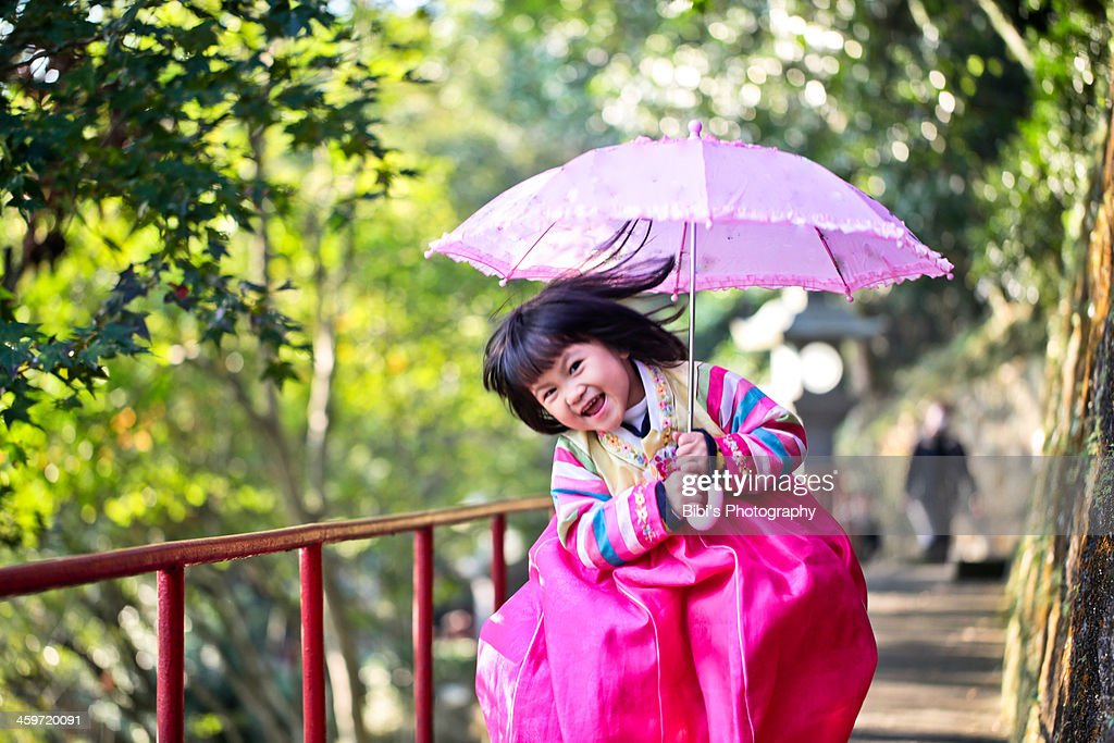 Little girl with traditional clothing : Stock Photo