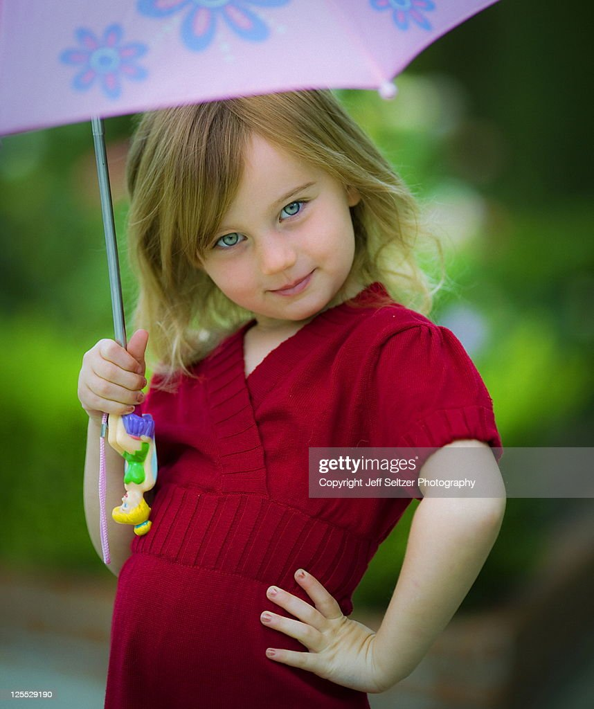 little with umbrella stock photo getty images